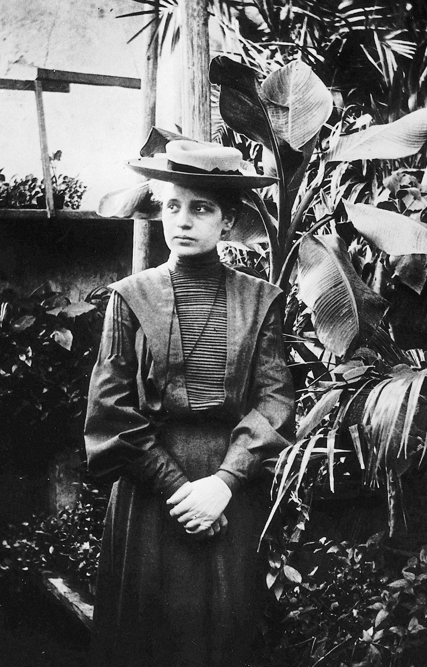 lise meitner standing by plants
